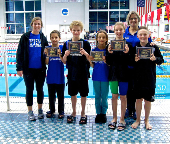 Picture of youth swimmers and their awards